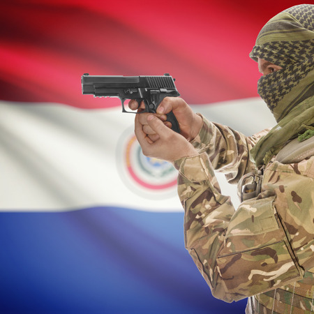 insurgency: Man with gun in hand and national flag on background series - Paraguay