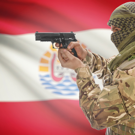 counterterrorism: Man with gun in hand and national flag on background series - French Polynesia