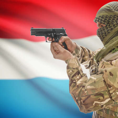 national police agency: Man with gun in hand and national flag on background series - Luxembourg Stock Photo