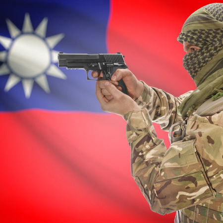 insurgency: Man with gun in hand and national flag on background series - Taiwan