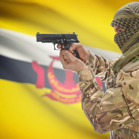 counter terrorism: Man with gun in hand and national flag on background series - Brunei Stock Photo