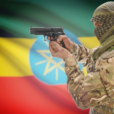 insurgency: Man with gun in hand and national flag on background series - Ethiopia