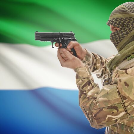 counter terrorism: Man with gun in hand and national flag on background series - Sierra Leone