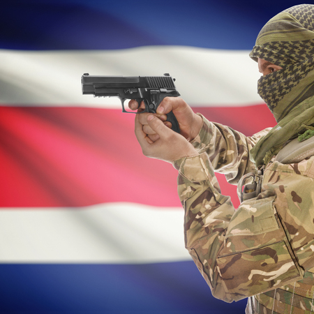 anti terrorist: Man with gun in hand and national flag on background series - Costa Rica Stock Photo