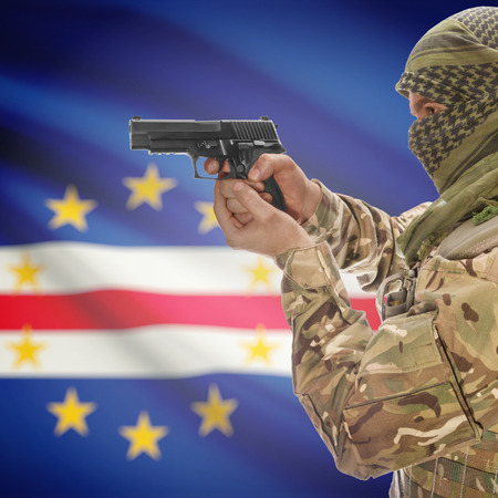 counterterrorism: Man with gun in hand and national flag on background series - Cape Verde Stock Photo