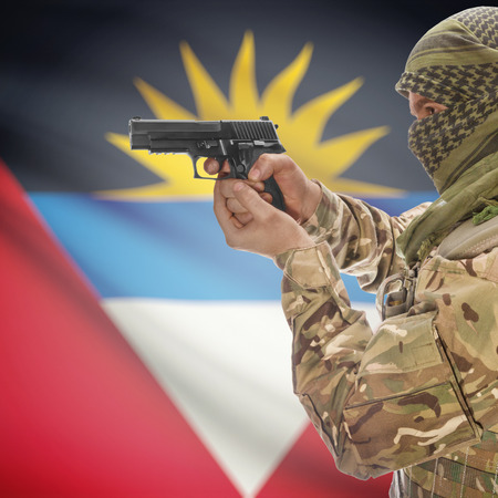 national police agency: Man with gun in hand and national flag on background series - Antigua and Barbuda