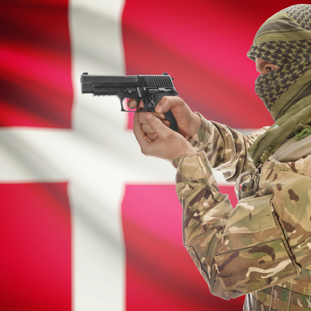 counter terrorism: Man with gun in hand and national flag on background series - Denmark