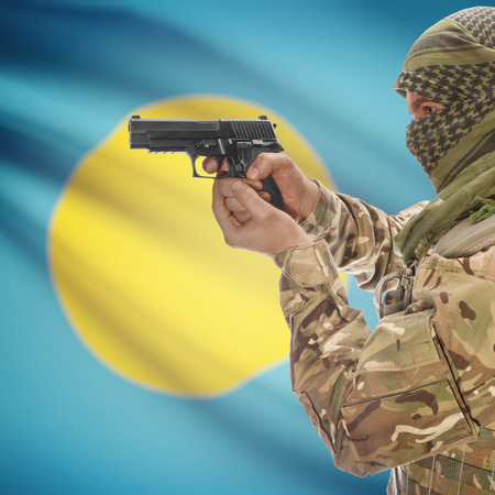 counterterrorism: Man with gun in hand and national flag on background series - Palau