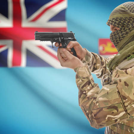 counterterrorism: Man with gun in hand and national flag on background series - Fiji Stock Photo