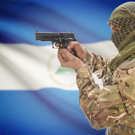 counter terrorism: Man with gun in hand and national flag on background series - Nicaragua Stock Photo
