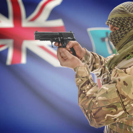 counterterrorism: Man with gun in hand and national flag on background series - Montserrat Stock Photo