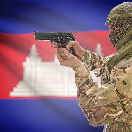 counterterrorism: Man with gun in hand and national flag on background series - Cambodia Stock Photo