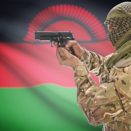 insurgency: Man with gun in hand and national flag on background series - Malawi