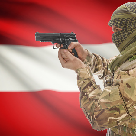 national police agency: Man with gun in hand and national flag on background series - Austria