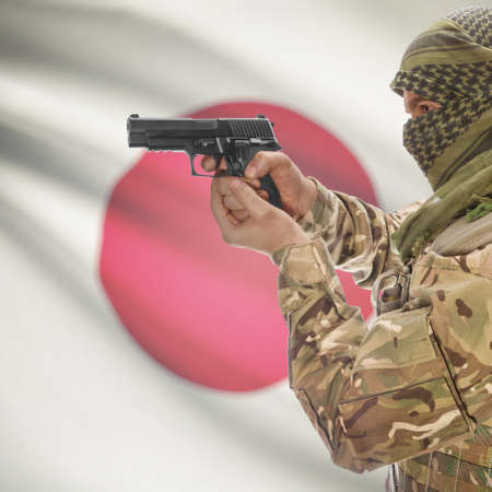 anti terrorist: Man with gun in hand and national flag on background series - Japan Stock Photo