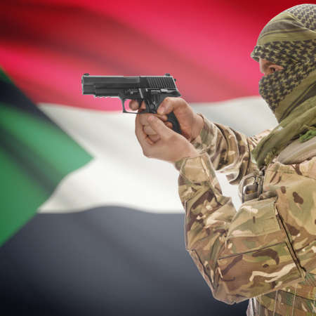 counterterrorism: Man with gun in hand and national flag on background series - Sudan