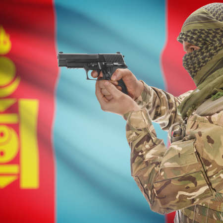 counterterrorism: Man with gun in hand and national flag on background series - Mongolia