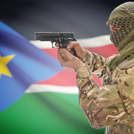 national police agency: Man with gun in hand and national flag on background series - South Sudan Stock Photo
