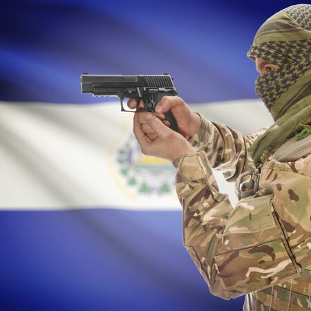 insurgency: Man with gun in hand and national flag on background series - El Salvador