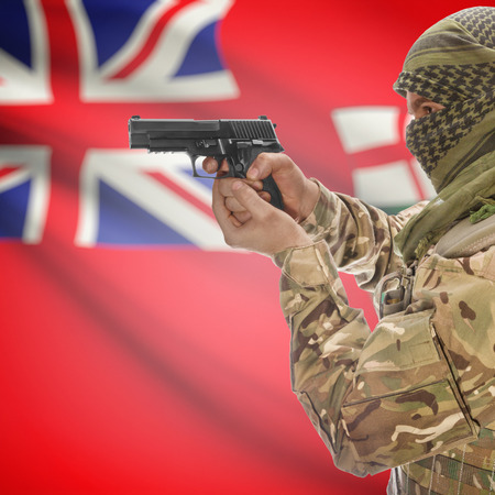canadian military: Male with gun in hand and Canadian province flag on background series - Ontario Stock Photo