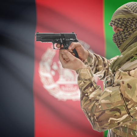 national police agency: Man with gun in hand and national flag on background series - Afghanistan