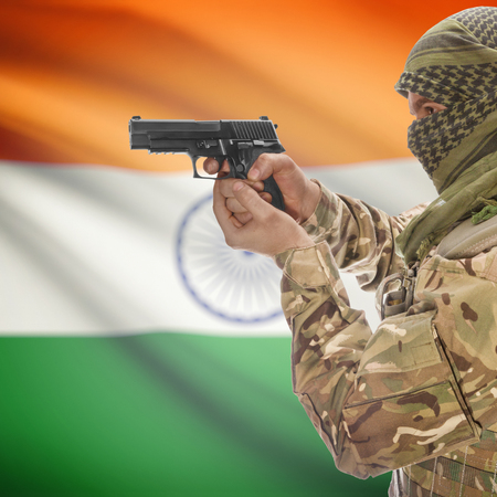 counterterrorism: Man with gun in hand and national flag on background series - India