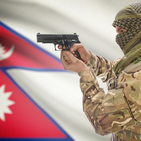counterterrorism: Man with gun in hand and national flag on background series - Nepal Stock Photo