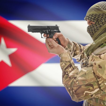 insurgency: Man with gun in hand and national flag on background series - Cuba