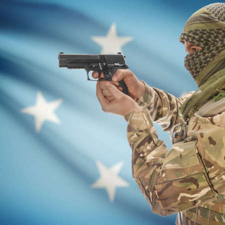 insurgency: Man with gun in hand and national flag on background series - Micronesia Stock Photo