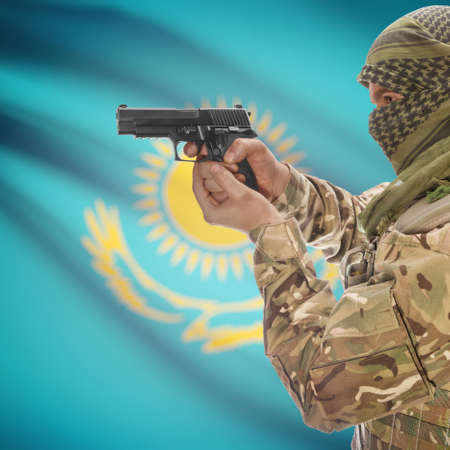 counterterrorism: Man with gun in hand and national flag on background series - Kazakhstan