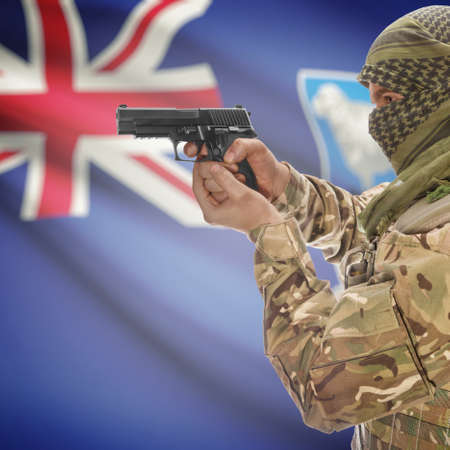anti terrorist: Man with gun in hand and national flag on background series - Falkland Islands