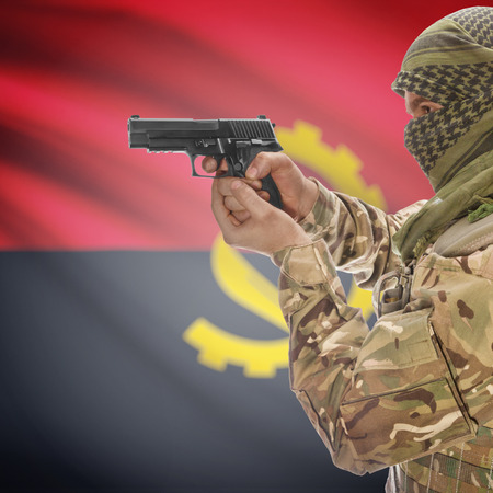 counterterrorism: Man with gun in hand and national flag on background series - Angola