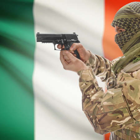 insurgency: Man with gun in hand and national flag on background series - Ireland