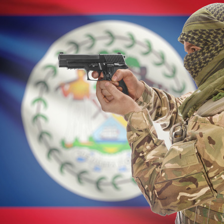 national police agency: Man with gun in hand and national flag on background series - Belize