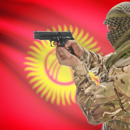 national police agency: Man with gun in hand and national flag on background series - Kyrgyzstan