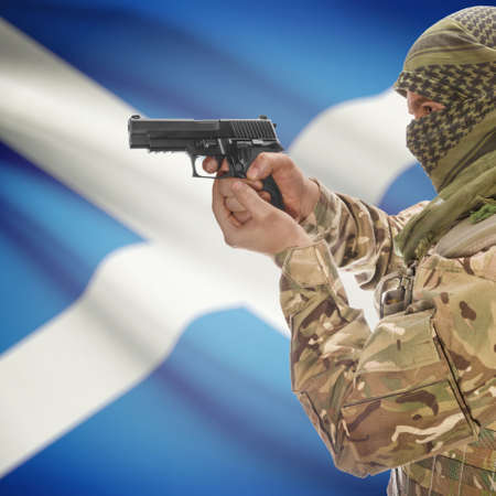 national police agency: Man with gun in hand and national flag on background series - Scotland