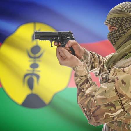 counterterrorism: Man with gun in hand and national flag on background series - New Caledonia Stock Photo
