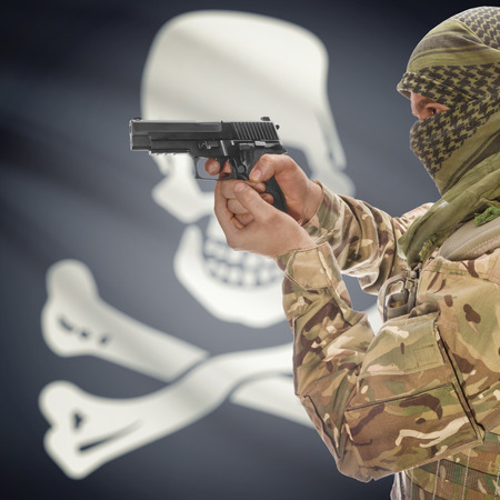 piracy: Male with gun in hand and American state flag on background series - Jolly Roger - symbol of piracy Stock Photo