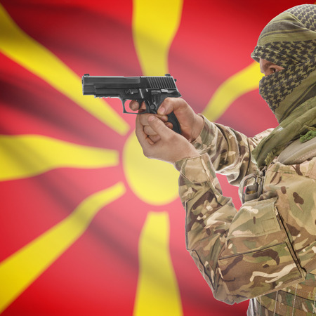 counterterrorism: Man with gun in hand and national flag on background series - Macedonia