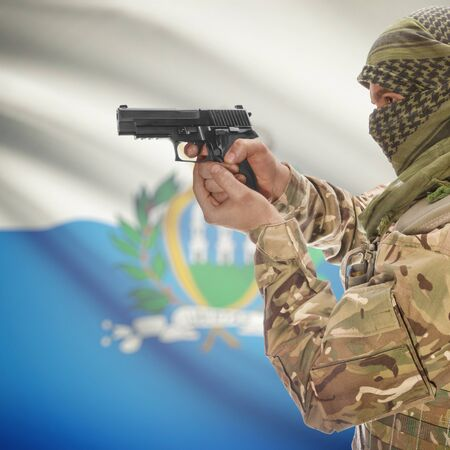counterterrorism: Man with gun in hand and national flag on background series - San Marino