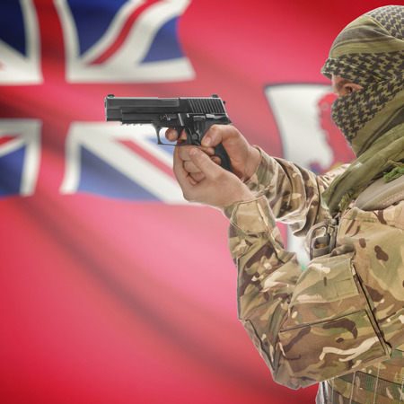 counterterrorism: Man with gun in hand and national flag on background series - Bermuda