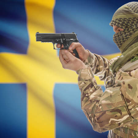 national police agency: Man with gun in hand and national flag on background series - Sweden Stock Photo