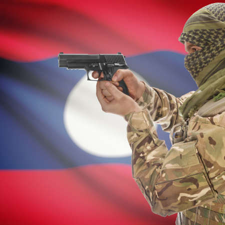 counterterrorism: Man with gun in hand and national flag on background series - Laos