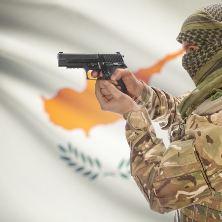 counter terrorism: Man with gun in hand and national flag on background series - Cyprus