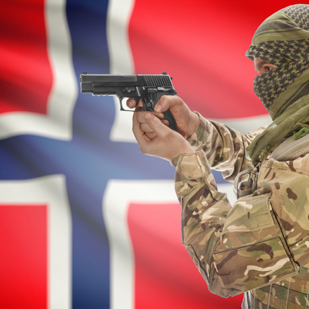 national police agency: Man with gun in hand and national flag on background series - Norway Stock Photo