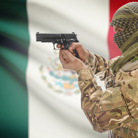counterterrorism: Man with gun in hand and national flag on background series - Mexico