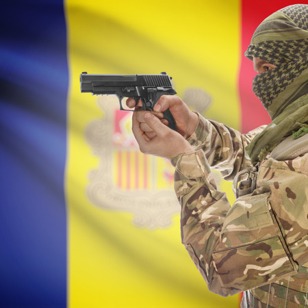 anti terrorist: Man with gun in hand and national flag on background series - Andorra Stock Photo