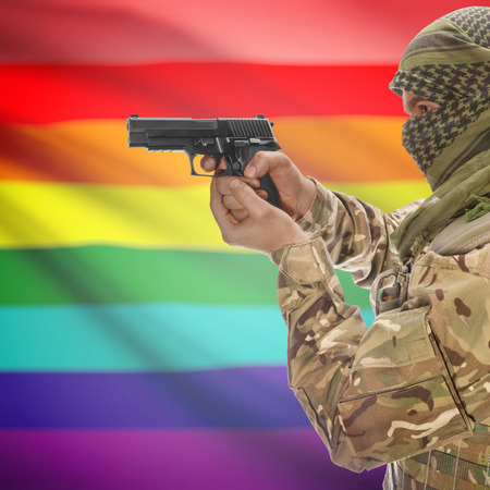 counterterrorism: Man with gun in hand and national flag on background series - LGBT people Stock Photo