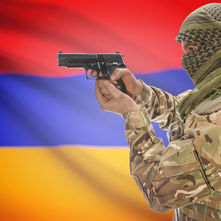 anti terrorist: Man with gun in hand and national flag on background series - Armenia Stock Photo