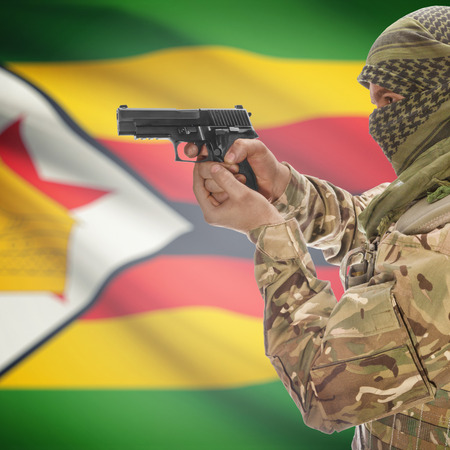 counterterrorism: Man with gun in hand and national flag on background series - Zimbabwe